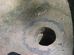 Image 11:  Caulk residue at central hole in bowl.